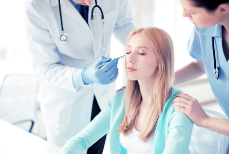 plastic: bright picture of male plastic surgeon with patient Stock Photo
