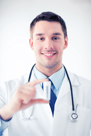 testtube: healthcare and medical - young male doctor with empty test-tube Stock Photo