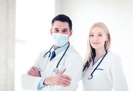 medical doctors: healthcare and medical concept - picture of two young attractive doctors