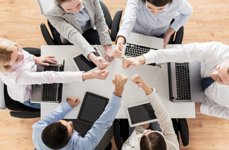 laptop computers: business, people, technology and team work concept - close up of creative team with laptop and tablet pc computers showing thumbs up gesture and sitting at table in office