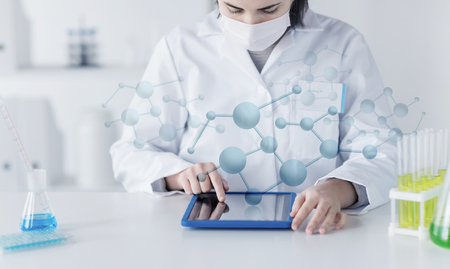 researcher: science, chemistry, biology, medicine and people concept - close up of young female scientist with tablet pc computer making test or research in clinical laboratory