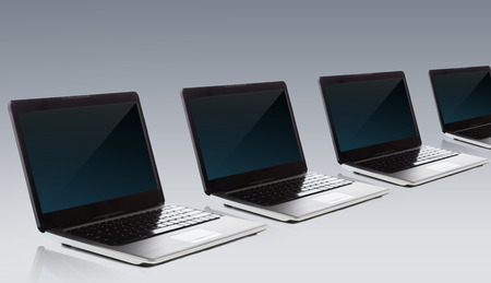 notebook computer: technology and advertisement concept - laptop computers with blank black screen over gray background