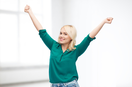 woman white shirt: female, gender, joy, plus size and people concept - happy young woman in shirt and jeans over white room background Stock Photo
