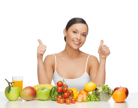 woman with lot of fruits and vegetables showing thumbs up