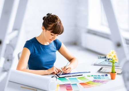 interior design and renovation concept - woman working with color samples for selection Stock Photo