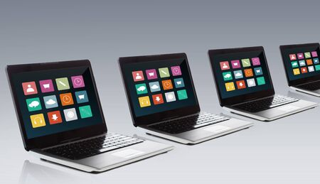notebook computer: technology, media, multimedia and advertisement concept - laptop computer with application icons menu on screen over gray background