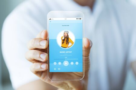 playing music: technology, media and people concept - close up of male hand holding and showing transparent smartphone with music player playing track