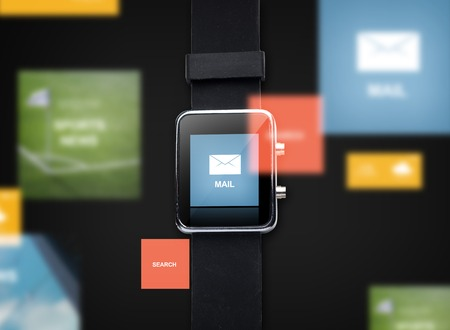 close icon: modern technology, communication, application, object and media concept - close up of black smart watch with e-mail message icon on screen
