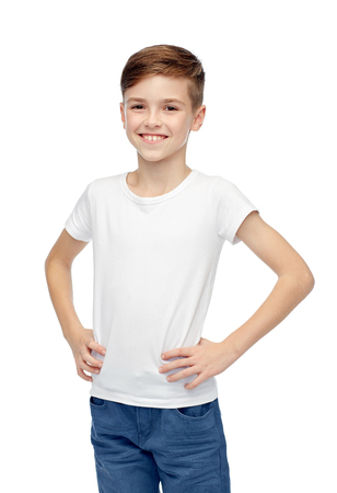 fashion boy: childhood, fashion, advertisement and people concept - happy boy in white t-shirt and jeans