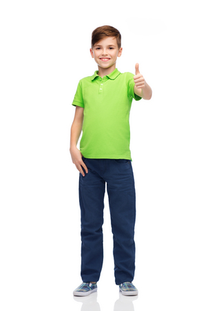 green clothes: gesture, childhood, fashion and people concept - happy smiling boy in green polo t-shirt showing thumbs up