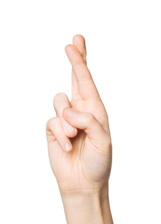comunicacion no verbal: el gesto y las partes del cuerpo concepto - cerca de la mano que muestra dos dedos cruzados Foto de archivo