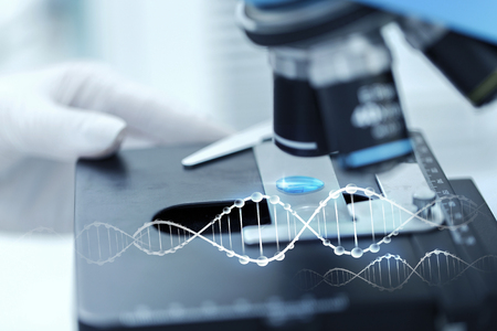 clinical: science, chemistry, biology, medicine and people concept - close up of scientist hand with test sample making research in clinical laboratory with dna molecule structure