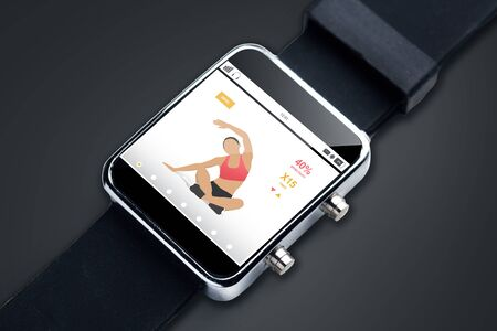 sport object: modern technology, sport, fitness, object and media concept - close up of black smart watch with sports application on screen Stock Photo