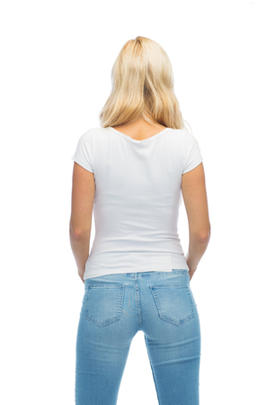 back view: fashion, style, advertisement and people concept - rear view of young woman in blank white t-shirt