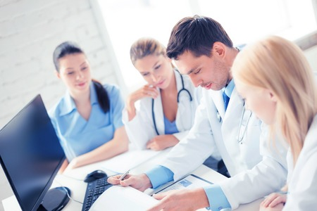 medical doctor: picture of young team or group of doctors working