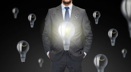 ligh: business, inspiration, startup, idea and people concept - close up of businessman in suit with ligh bulb icons Stock Photo