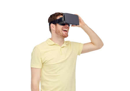 mediated: 3d technology, virtual reality, entertainment and people concept - happy young man with virtual reality headset or 3d glasses