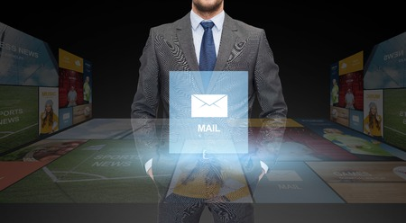 close icon: business, communication, multimedia and people concept - close up of businessman in suit with email icon