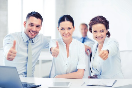 showing: business concept - business team showing thumbs up in office Stock Photo