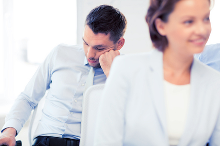 business concept - tired businessmen sleeping on conference or meeting Stock Photo
