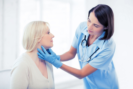 surgeons: healthcare, medical and plastic surgery concept - plastic surgeon or doctor with patient Stock Photo
