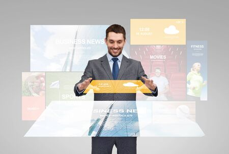 news cast: business, multimedia, forecast and people concept - happy businessman in suit with news applications on virtual screens and weather cast Stock Photo