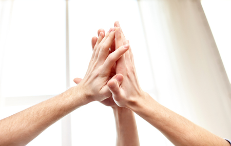 hands high: people, win, friendship, teamwork and success concept - close up of hands making high five gesture