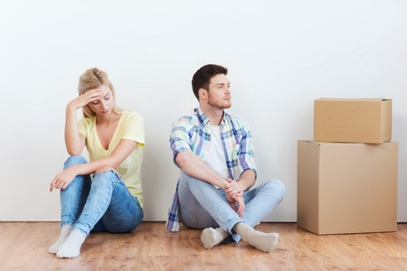 moving out: people, relationship difficulties, divorce, conflict and family concept - unhappy couple having argument or break up at home