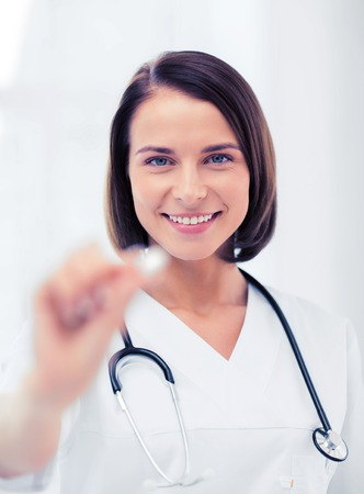 contraception: healthcare and medical concept - doctor with tablet in hospital