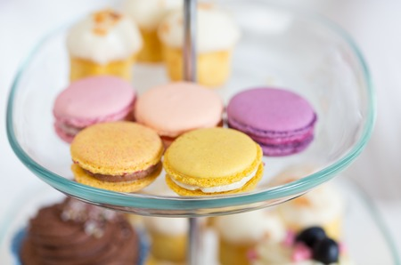 dessert stand: unhealthy eating, sweets, dessert, baking and junk food concept - close up of cake stand with macaroon cookies Stock Photo