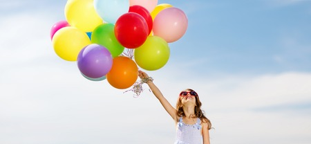 children celebration: summer holidays, celebration, family, children and people concept - happy girl with colorful balloons