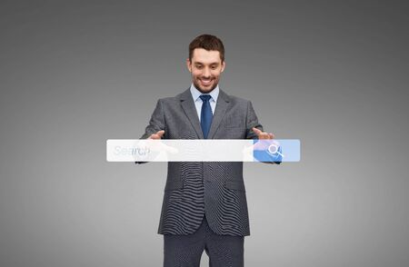 touch screen: business, technology and people concept - smiling businessman working with internet search bar