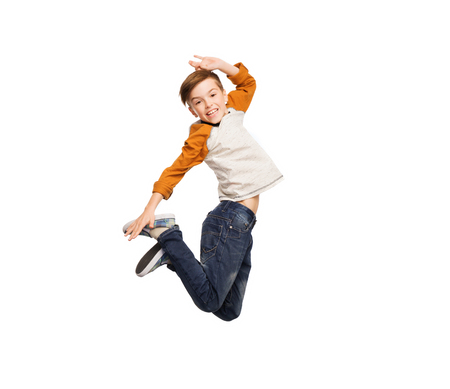 bewegung menschen: happiness, childhood, freedom, movement and people concept - happy smiling boy jumping in air Lizenzfreie Bilder