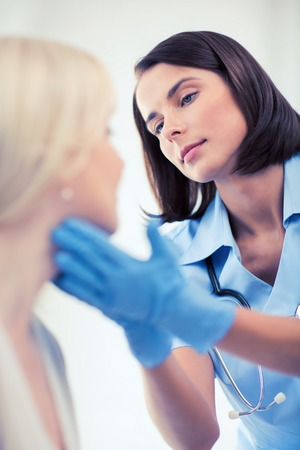 nose: healthcare, medical and plastic surgery concept - plastic surgeon or doctor with patient Stock Photo