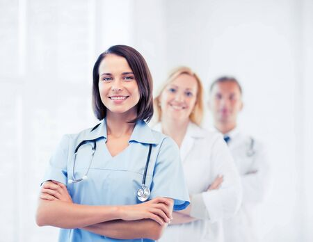 physiotherapists: healthcare and medical concept - group of doctors