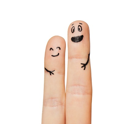 body parts: gesture, family, couple, people and body parts concept - close up of two fingers with smiley faces Stock Photo