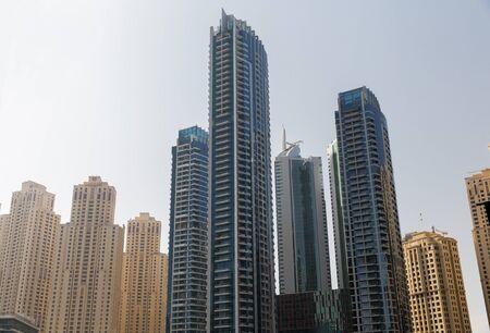 megalopolis: cityscape, travel, tourism and urban concept - Dubai city business district with skyscrapers