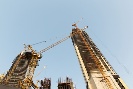 industry architecture: construction, development, architecture, industry and engineering concept - building of skyscraper in Dubai city Stock Photo
