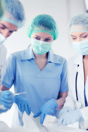 medical doctors: healthcare and medical - young group of doctors doing operation Stock Photo