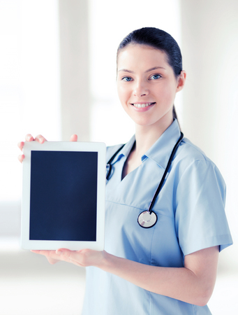 healthcare and medical concept - female doctor with tablet pc