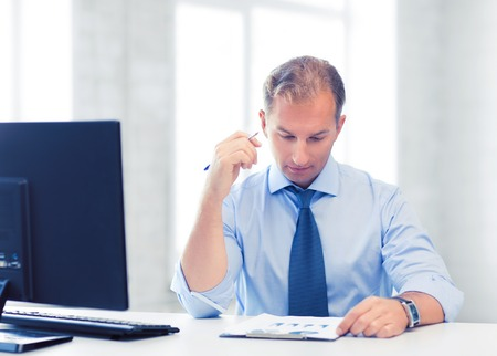 computer office: picture of handsome businessman writing in notebook