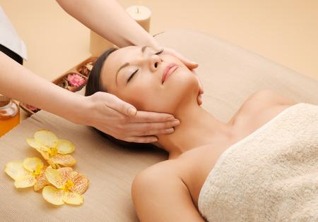 restore: picture of calm beautiful woman in massage salon Stock Photo