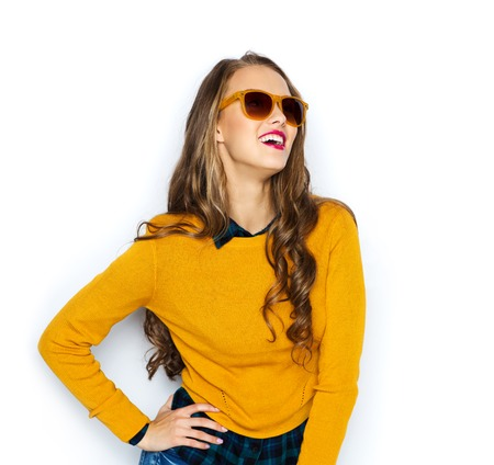 casual fashion: people, style and fashion concept - happy young woman or teen girl in casual clothes and sunglasses