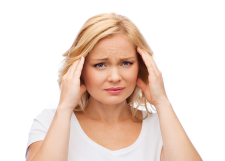 middle age: people, healthcare, stress and problem concept - unhappy woman suffering from headache Stock Photo