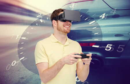 entertainment background: 3d technology, virtual reality, entertainment and people concept - happy man in virtual reality headset with game controller gamepad playing car racing game over tachometer and street race background