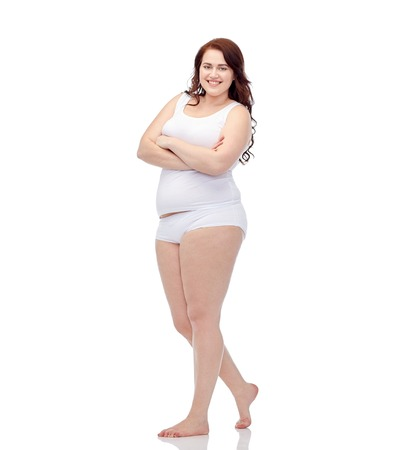 plus size and people concept - happy plus size woman in underwear