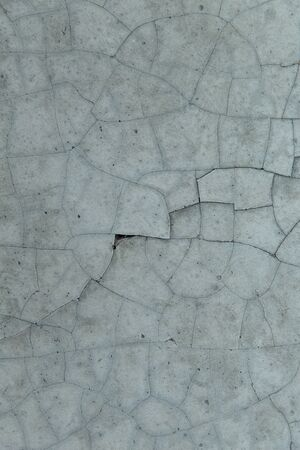 cracked concrete: background and texture concept - cracked gray concrete wall