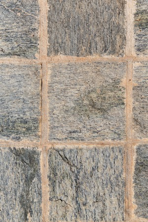stonework: architecture, stonework and tiled masonry concept - close up of paving stone or facade tile texture