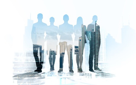 multiple exposure: business, teamwork and people concept - business people silhouettes over city background with double exposure effect