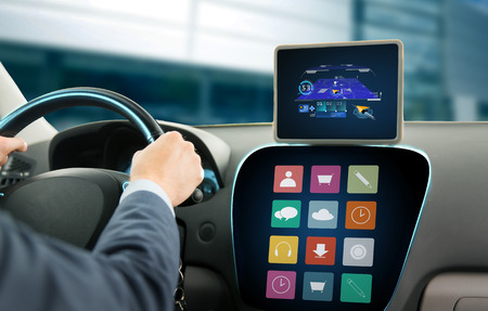 onboard: transport, business trip, technology, navigation and people concept - close up of young man with gps navigator on tablet pc and on-board computer menu driving car